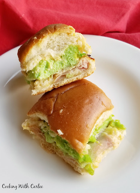 two small sandwiches with green eggs and ham in them