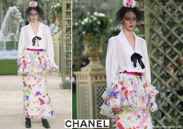 Princess Caroline wore a white silk shirt and floral print skirt by Chanel