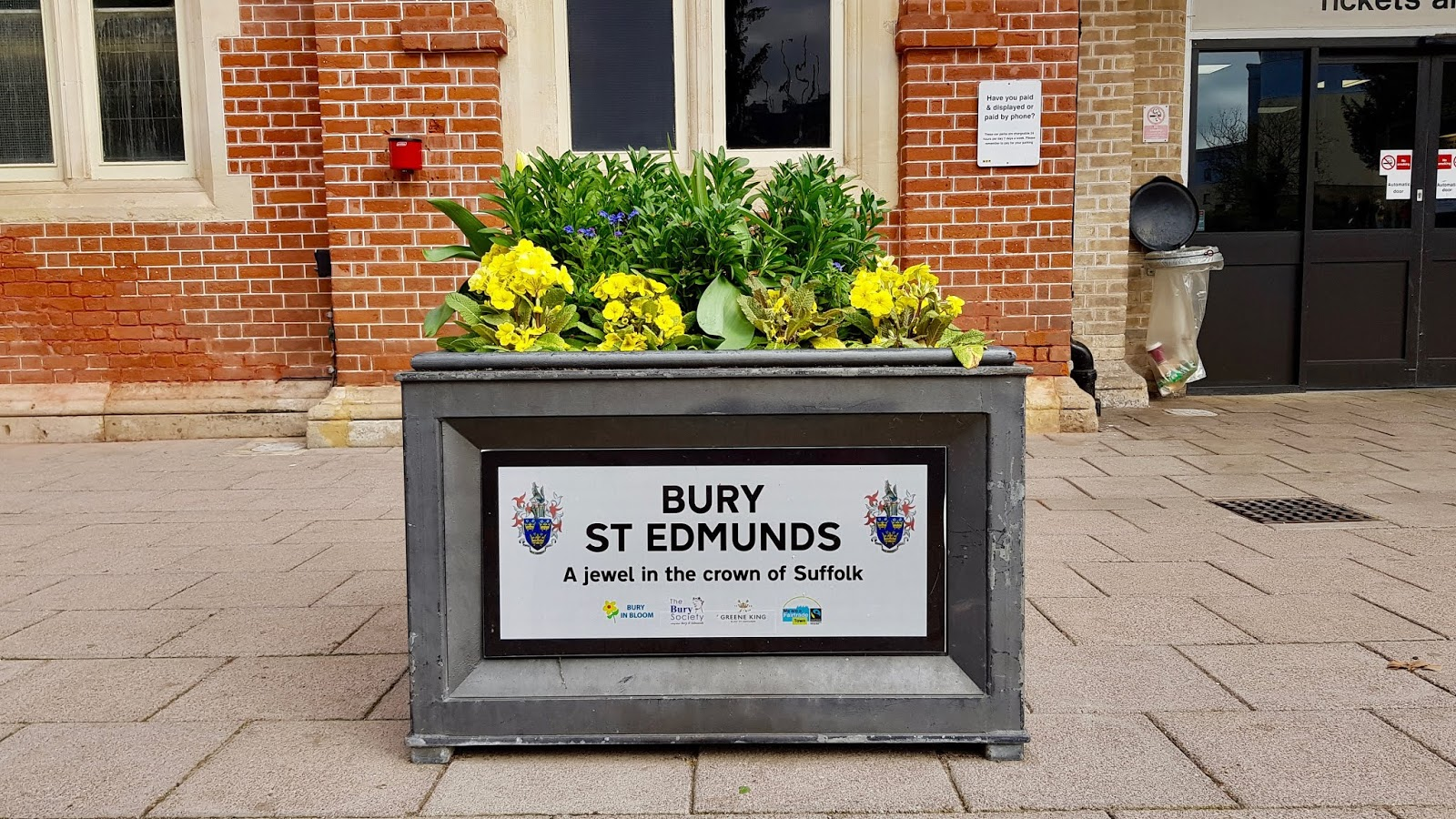 "A flower planter labelled with ""Bury St Edmunds"""