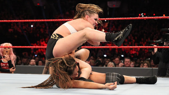 WWE Raw Women's Champion Ronda Rousey def. Liv Morgan and Sarah Logan