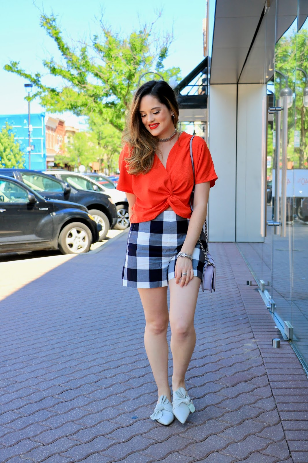 Nyc fashion blogger of Kat's Fashion Fix, Kathleen Harper, showing how to wear high-waisted plaid shorts in 2018