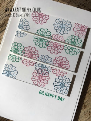 A white greetings card with a horizontal Triptych composed of stamped flowers using the Touches of Texture stamp set by Stampin' Up!