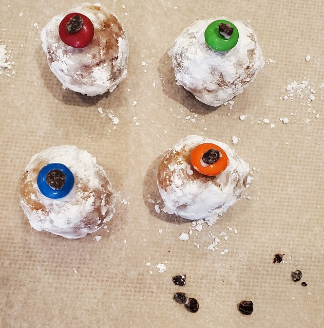 donut holes filled with jam made into eyeballs for Halloween
