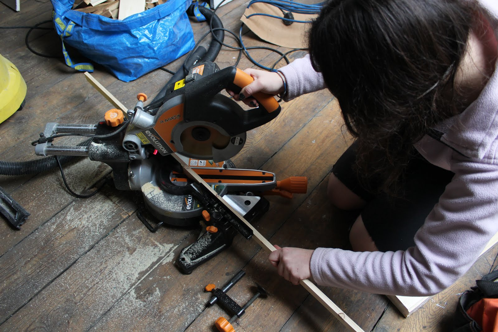 girls using mitre saw