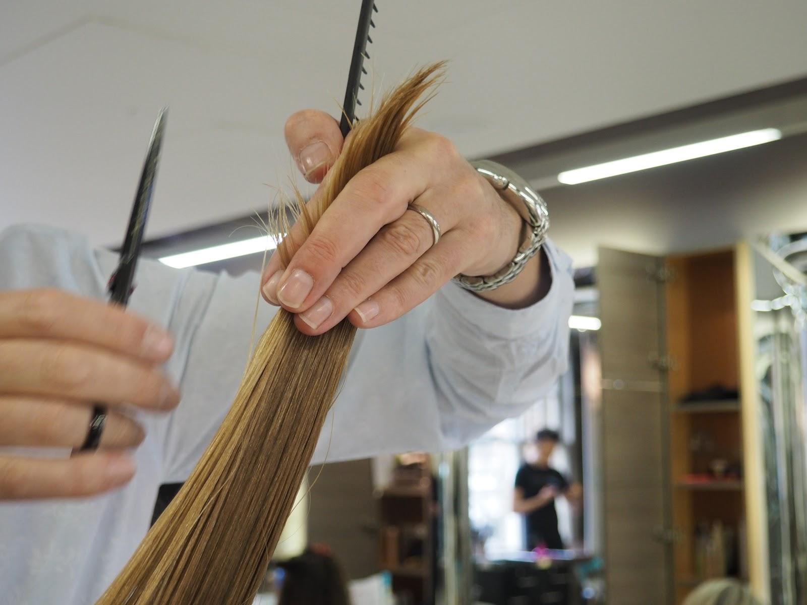 Richard Ward cutting blonde hair in the salon, Chelsea, London