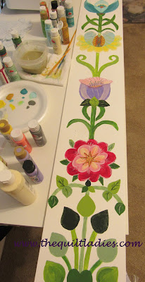 Adding painted flowers to doorway glass