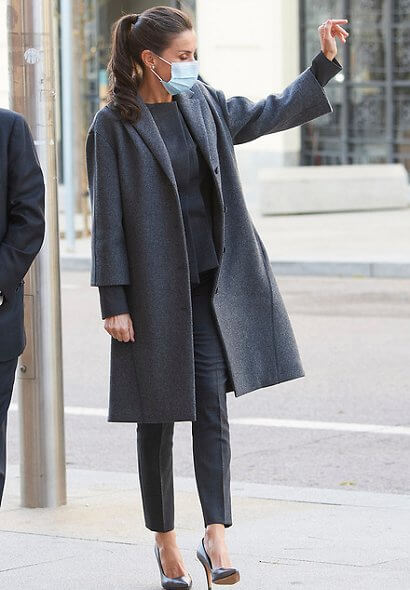 Queen Letizia wore a tweed swing coat from Nina Ricci, and wore a jadela stretch virgin wool asymmetrical blazer from Hugo Boss. Magrit pumps