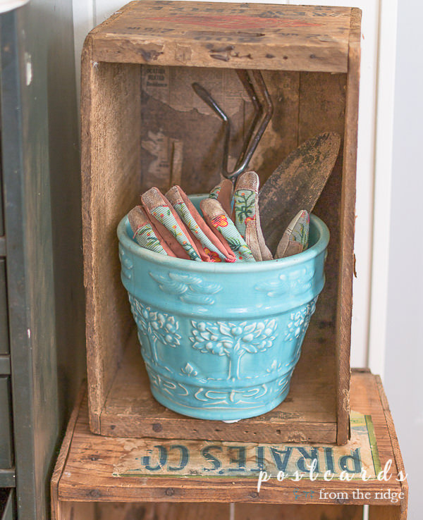 vintage mccoy planter with garden gloves and hand tools