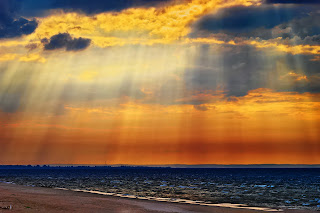 Crepuscular rays over the Baltic Sea. Image via Adobe Stock.