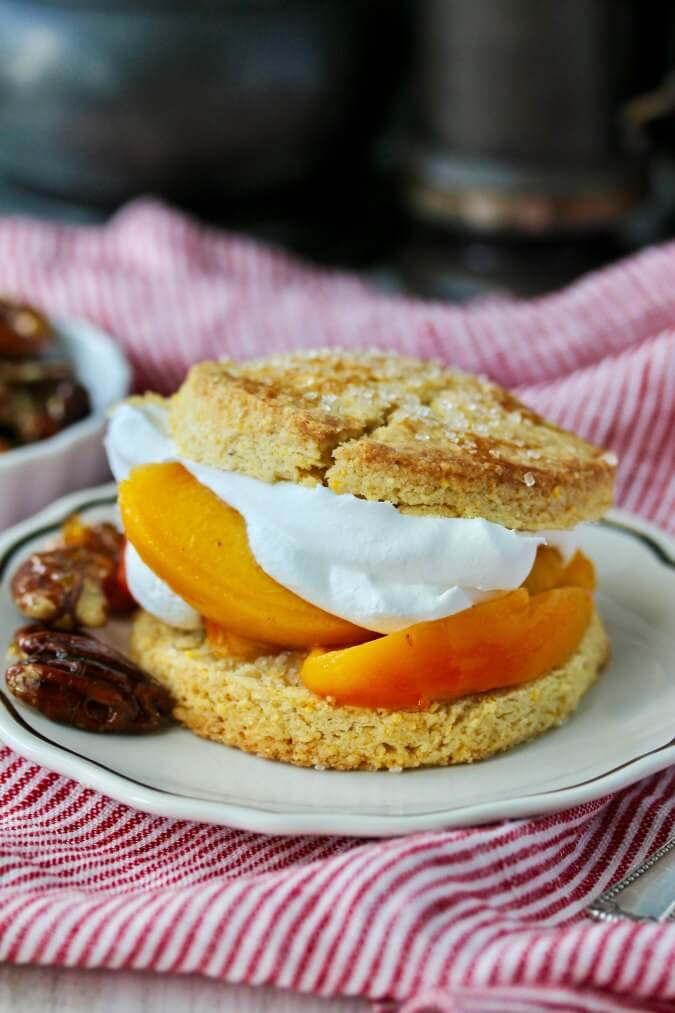 Shortcakes with Peaches Candied Pecans and whipped cream