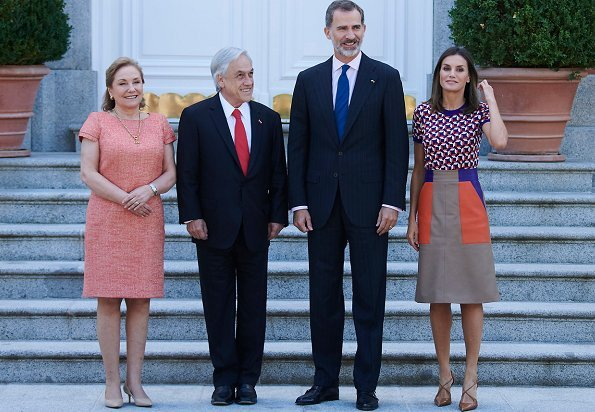 Queen Letizia wore Hugo Boss Seplea colorblock leather skirt, Boss Felisabeth Short sleeved sweater. President Sebastian Pinera and Cecilia Morel