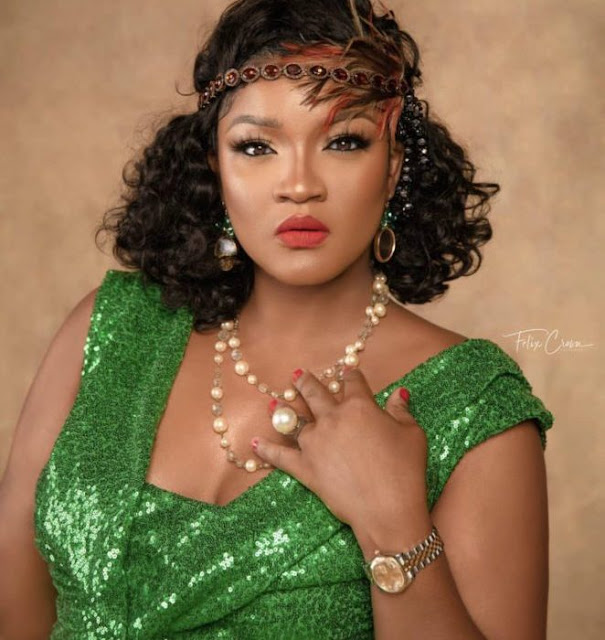 Omotola stuns in shimmery emerald green outfit