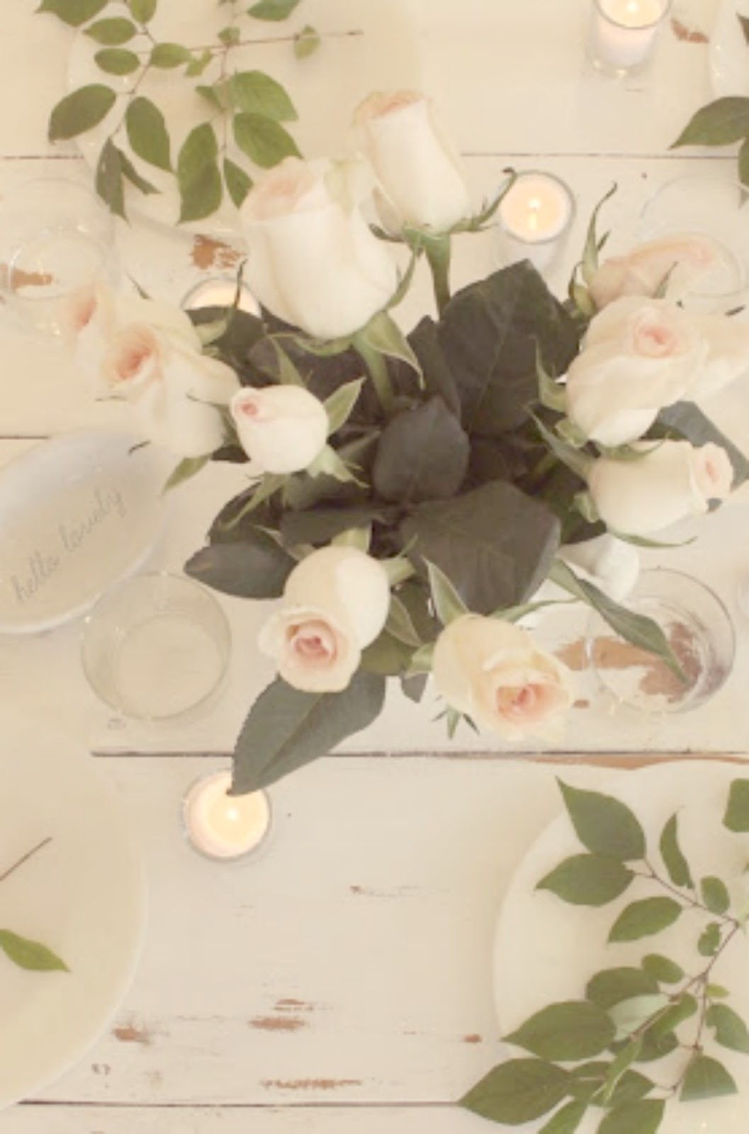 Pale pink, green, white, and gold romantic feminine tablescape with roses by Hello Lovely Studio
