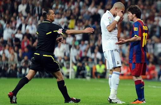 Pepe argues with Lionel Messi after the latter kicked the ball into the Real Madrid fans