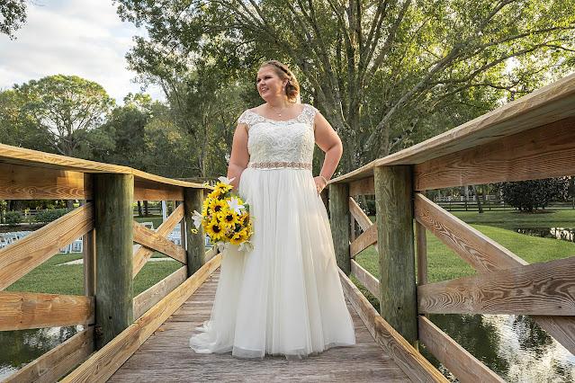 Bride posing on wooded bridge Magnolia Manor Wedding Photos by Stuart Wedding Photographer Heather Houghton Photography