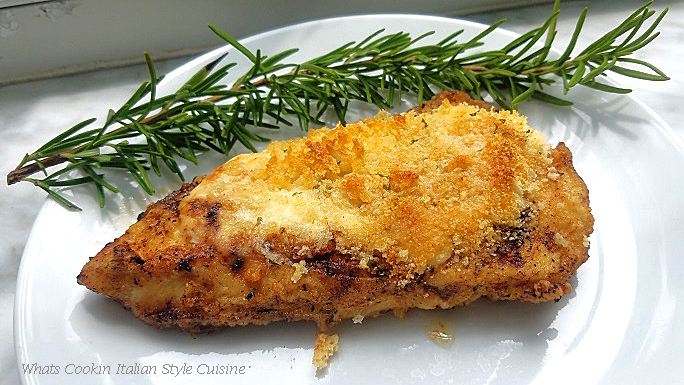 this is a copycat Longhorn Restaurant recipe for Parmesan Crusted Chicken on a white plate with a sprig of fresh rosemary on the plate