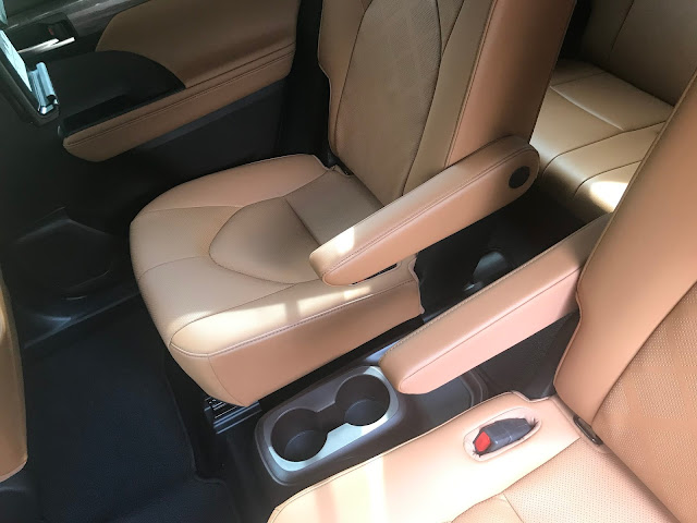 Rear seats and cupholders in 2020 Toyota Highlander Hybrid Platinum AWD
