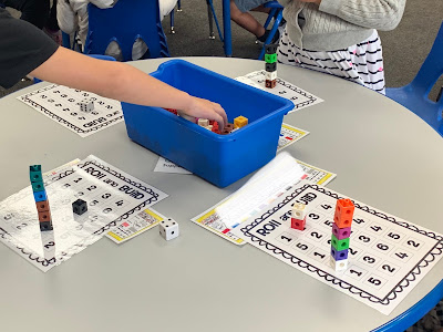 Roll and build tower math station