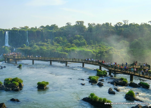 People braving the mist of Iguazu Falls.