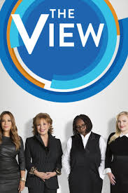 "A photograph of four women beneath a blue sign reading ""The View"""