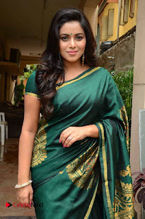 Actress Poorna Latest Pictures in Green Saree at SR Fashion Studio Launch  0006.jpg
