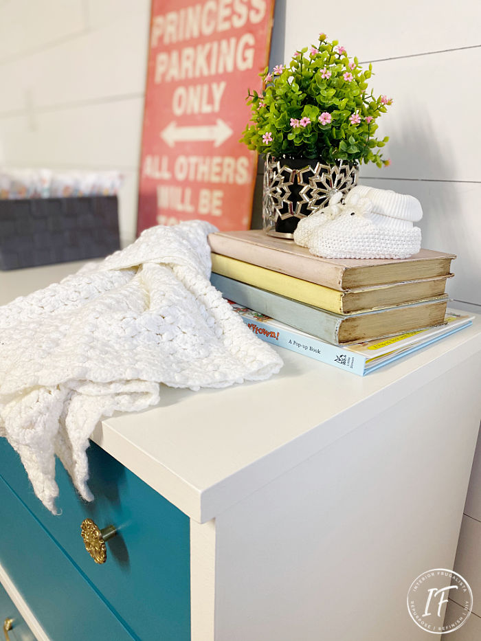 How to upcycle a second-hand dresser into a chic baby change table with mid-century modern style for a fraction of the cost of new nursery furniture.