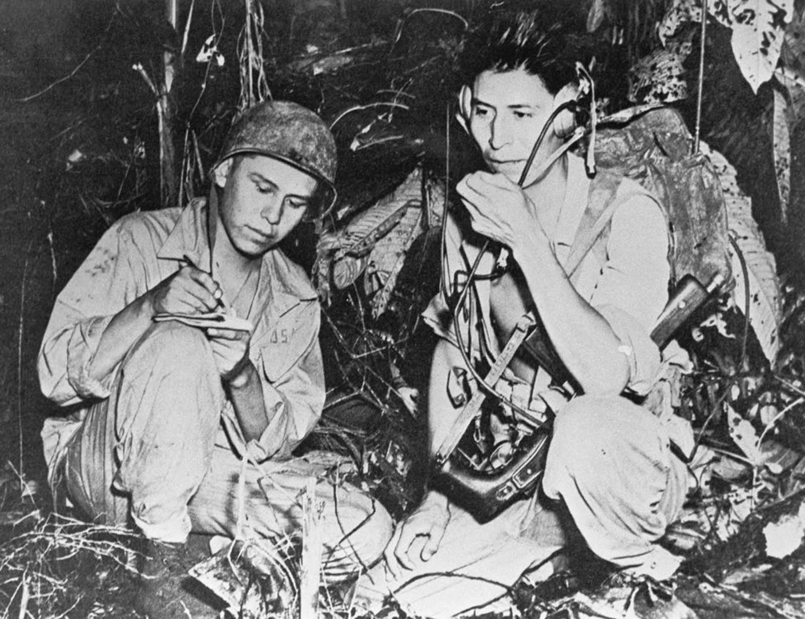 Code talkers transmit messages during the Battle of Bougainville. 1943.