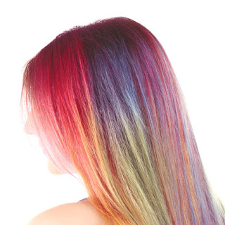 Make hair dye at home using Kool-aid!  The recipe is easy, and the colors are so vibrant!  This is the easiest and least expensive way to color your kids hair. #koolaidhairdye #koolaid #koolaidhairdyeforkids #hairdyeideas #homemadehairdye #hairdye