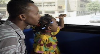 A girl narrates a film of herself taking the bus home with her dad. Sesame Street Elmo's Travel Songs and Games