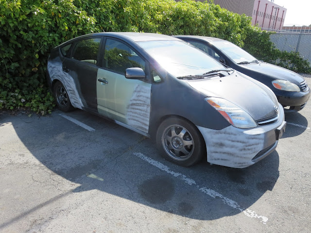 Car dealer faced with horrible trade-in chose single stage enamel overall paint job to keep costs low.