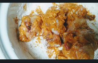 Mixing chicken lollipop with batter for chicken lollipop gravy recipe