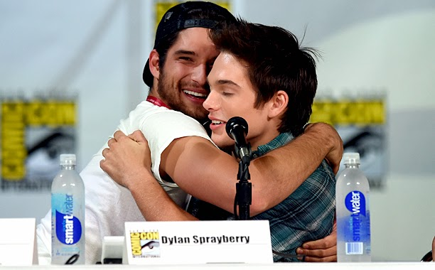 MTV's Teen Wolf at SDCC 14 panel. Hot actor embraces co-worker. smartwater and hugging.
