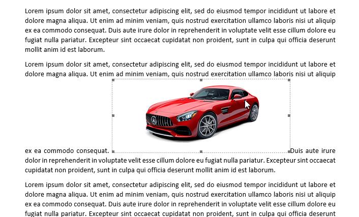 Gambar di tengah paragraf teks, dikelilingi kitak dengan garis putus dan kotak kecil abu-abu di setiap pojok dan tengah garis
