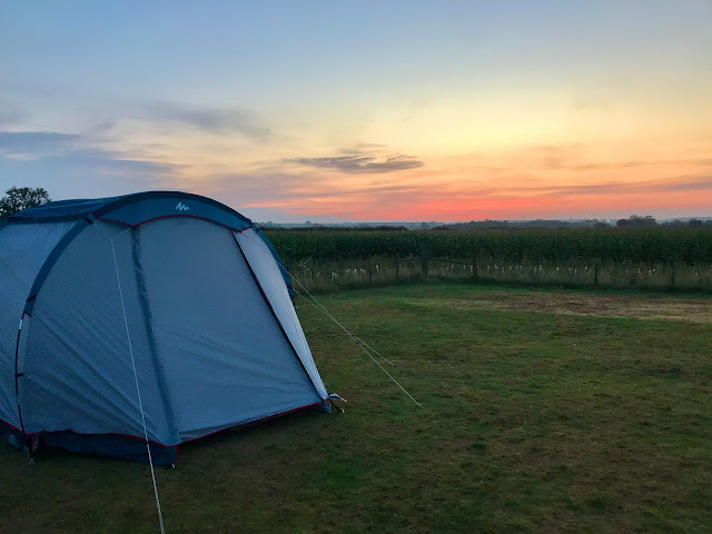 A tent and a sunset in an empty field my idea of the perfect post COVID UK staycation