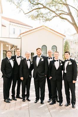 groom and groomsmen wearing black tux