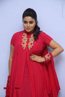 Actress Poorna Latest Stills in Red Dress at Rakshasi First Look Launch  0033.JPG