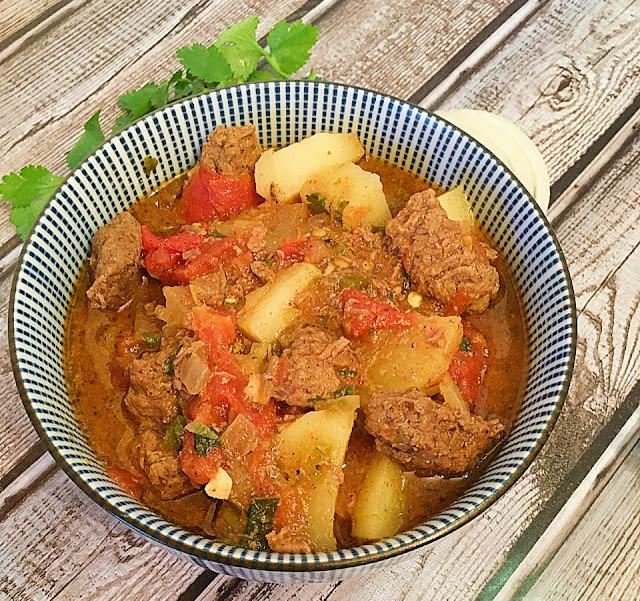 Carne Guisada in blue bowl