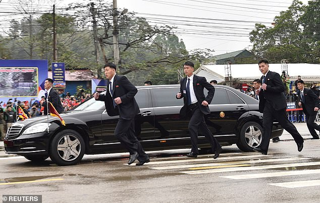 Dozens Of Bodyguards Surrounding Kim Jong Un's Limousine In Vietnam(Pics)