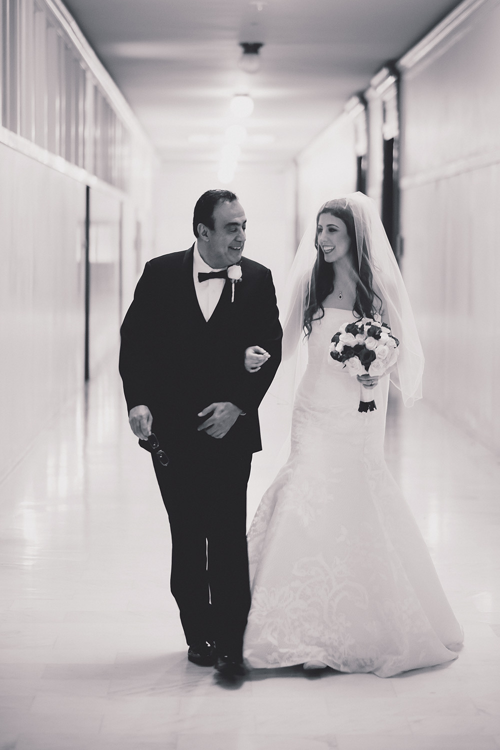 Father walking down the aisle with daughter - front shot