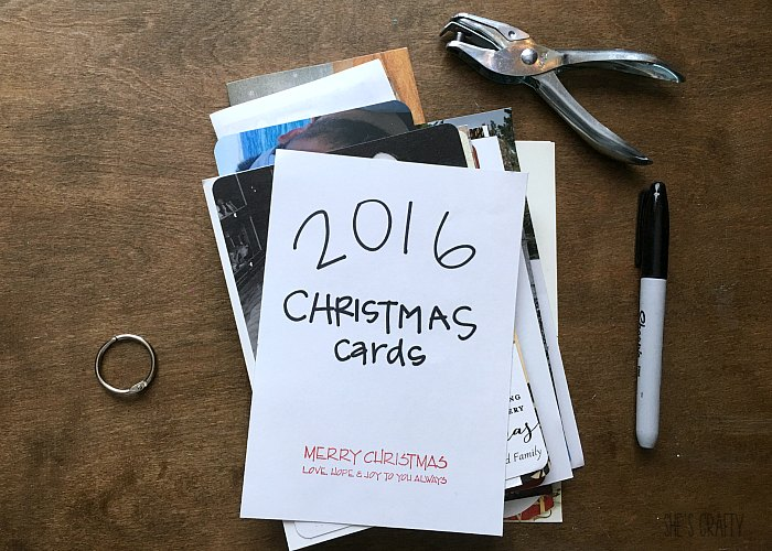 Christmas card book, hole punch, sharpie, book ring