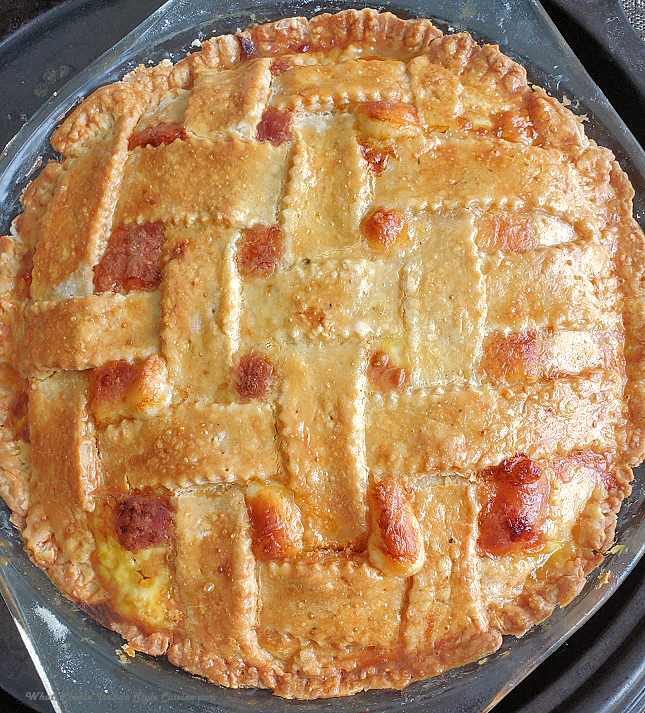 this is an Easter Italian Meat pie stuffed with many deli meats like pepperoni, capicola and salami loaded with ricotta and lots of other cheese baked in a glass deep dish pie plate