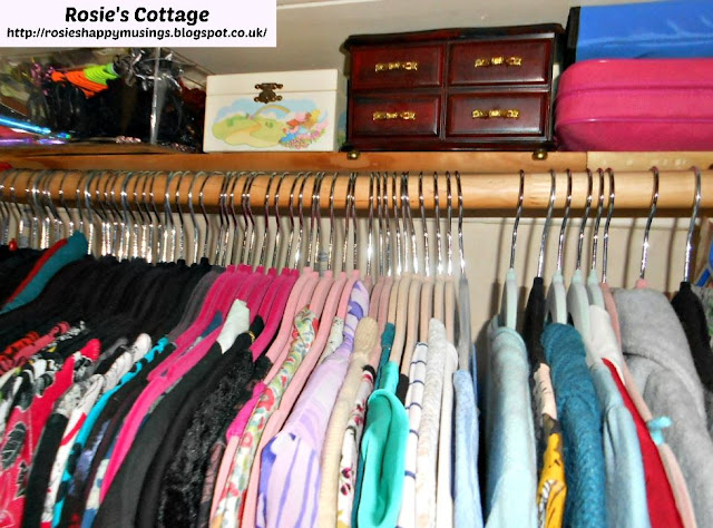 Closet shelf BEHIND the clothes rail - Fabulous use of space