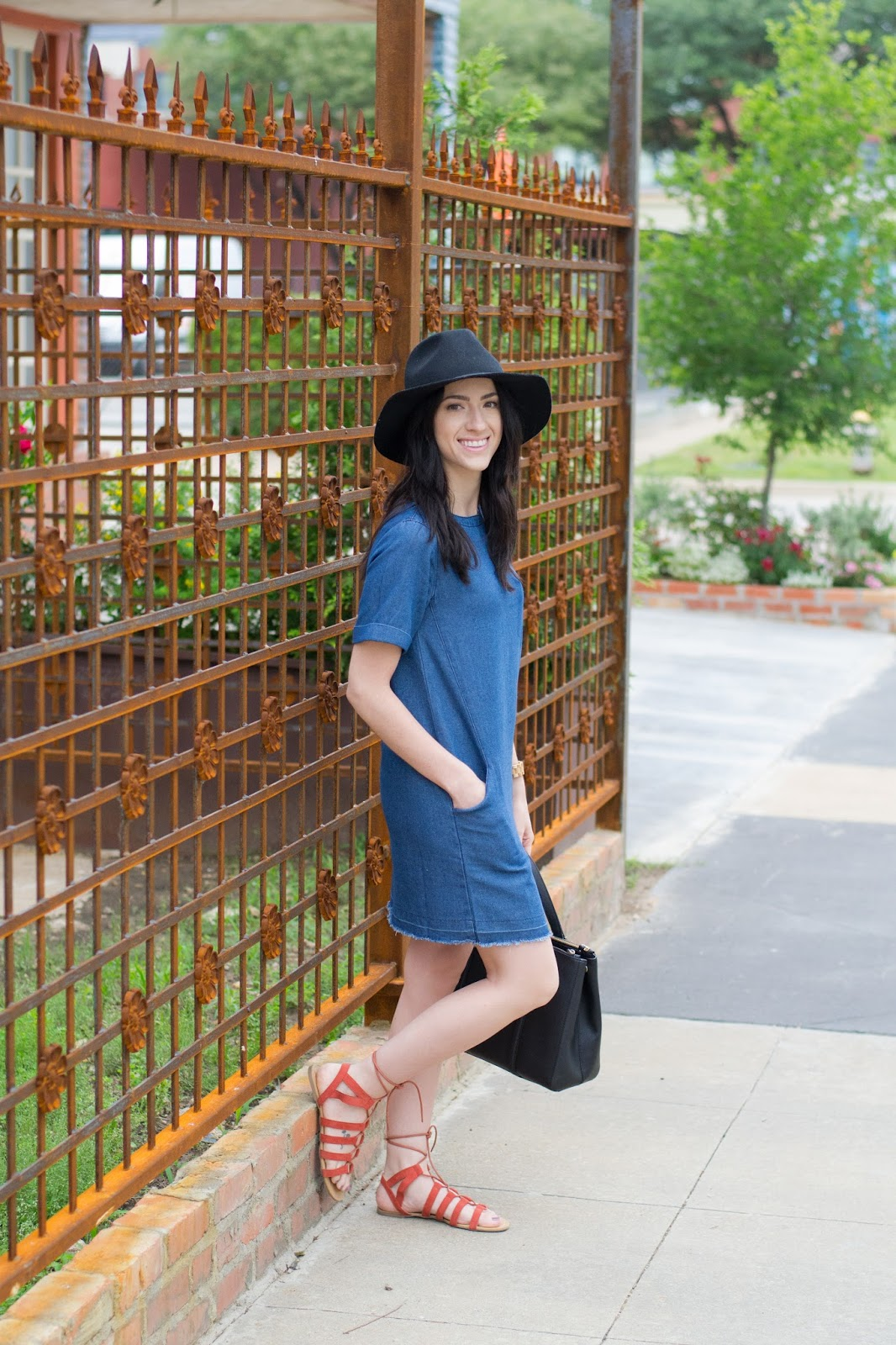 Casual weekend look wearing a simple denim dress and lace up sandals