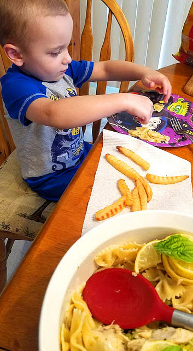A lemon sauce over bow tie pasta and my grandson Antonio eating the pasta in the photo