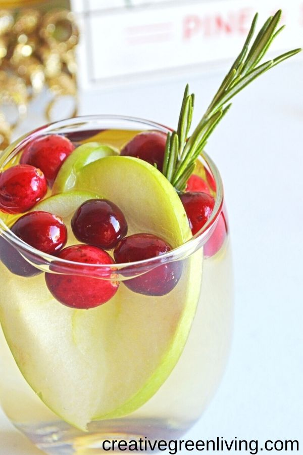 Sparkling white wine christmas sangria with oranges and cranberries