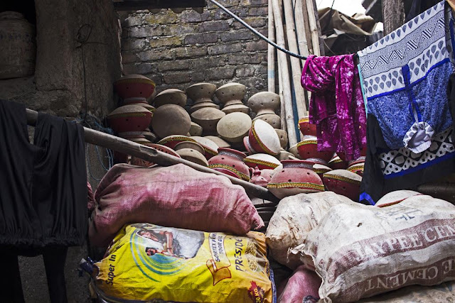 storage, space, pots, sacks, clothesline, kumbharwada, dharavi, pottters colony, mumbai, india,