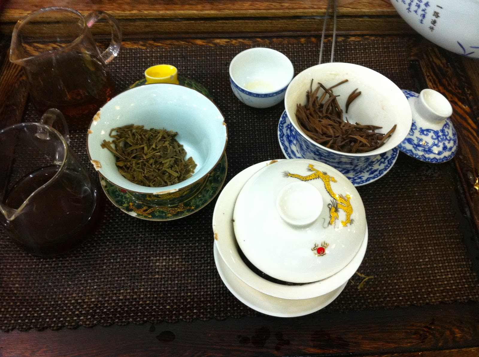 Tea leaves in tea pots for a tea tasting