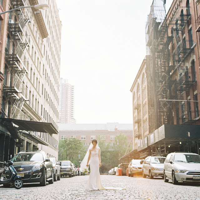 Jihyea on a cobblestone street before her intimate wedding at Locanda Verde | Karen Hill Photography