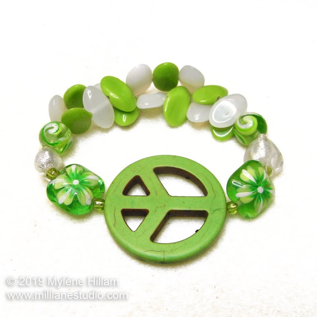 Green and white peace sign stretch bracelet