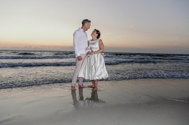 destination wedding on the beach bride in short wedding dress
